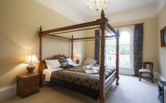 King Room 9 with a queen anne four poster bed