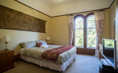 Queen Room 4 Decorated with tapestrys and pine tree views